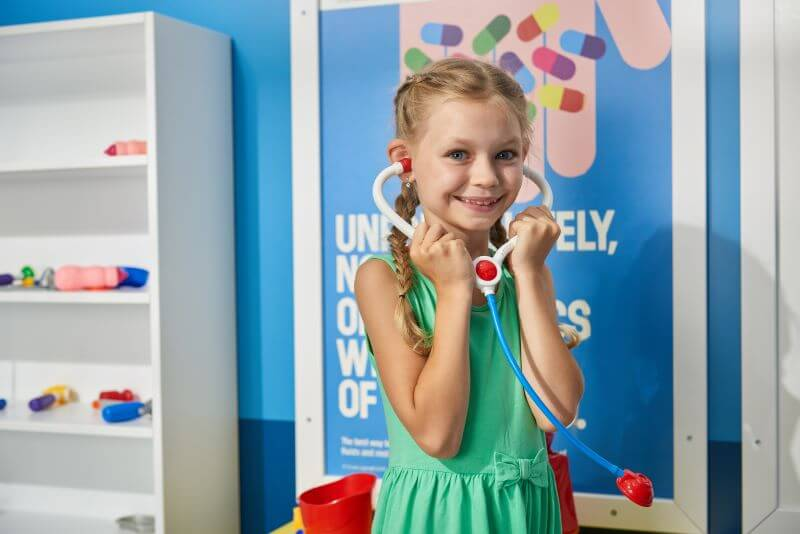 girl playing with toy stethoscope